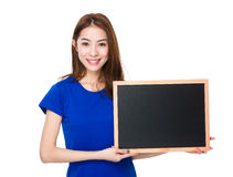 Woman show with chalkboard Stock Images