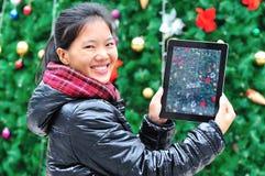 Woman show christams tree photo Stock Photos