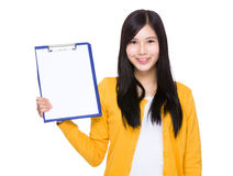 Woman show with clipboard Stock Images