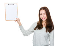 Woman show with clipboard. Isolated on white background Royalty Free Stock Images