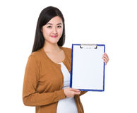 Woman show with clipboard. Isolated on white background Stock Image