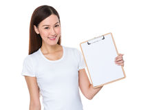 Woman show with clipboard. Isolated on white background Royalty Free Stock Image
