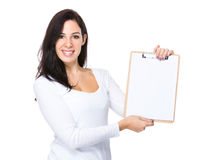 Woman show with clipboard. Isolated on white background Stock Photography