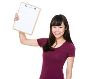 Woman show with clipboard. Isolated on white background Stock Photo