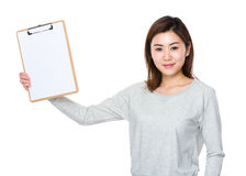 Woman show with clipboard. Isolated on white background Royalty Free Stock Photo