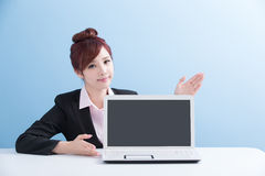 Woman show computer to you Stock Image