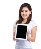 Woman show with digital tablet Royalty Free Stock Image