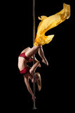 Woman show exercise in pole dance with fabric Royalty Free Stock Images