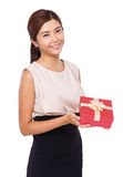 Woman show with gift box Stock Photo