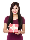 Woman show with giftbox Royalty Free Stock Photo