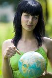 Woman show on global. Beautiful brunet woman show on global Royalty Free Stock Photography