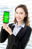 Woman show green screen of mobile. Asian businesswoman show green screen of mobile confidently in the office royalty free stock photos