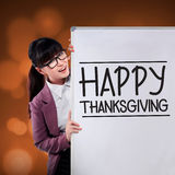 Woman Show Happy Thanksgiving On The Board Stock Photo