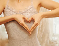 Woman show heart hands Royalty Free Stock Images