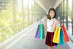 woman show her shopping  bag and credit card Royalty Free Stock Image