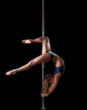 Woman show high gymnastic level during pole dance Royalty Free Stock Photos