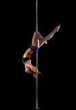 Woman show high gymnastic level during pole dance Royalty Free Stock Image