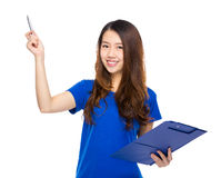 Woman show idea with pen and clipboard Stock Photo