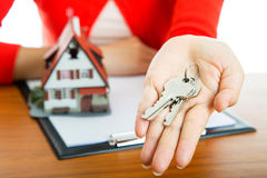 Woman show Keys for your good property Royalty Free Stock Images