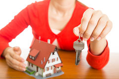 Woman show Keys for your good property with real agency propert Royalty Free Stock Image