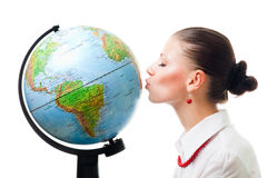 Woman show love to planet. Kissing the globe,isolated on white Stock Photography