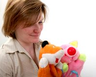 Woman show the puppet theater. Mother show puppet theater with handly toy fox and piggy Stock Image
