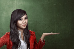 Woman show something with chalkboard background Stock Images