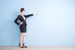 Woman show something to you. Business woman is smile and show something to you with blue background, asian stock photos