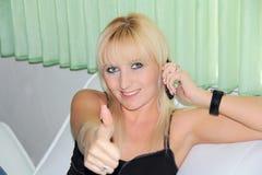 Woman show thumb upwards Stock Image