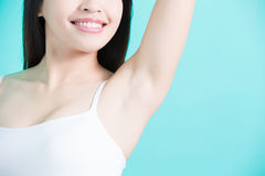 Woman show under armpit. Beauty woman smile happily with body odor problem Royalty Free Stock Photos