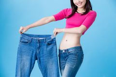 Woman show weight loss Royalty Free Stock Photography