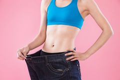 Woman show weight loss Stock Image