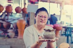 Woman show the work of pottery molding stock photography