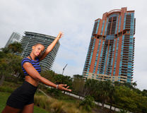 Woman showcasing a building Stock Image