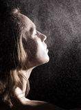 Woman in shower. Attractive woman in shower over dark background Stock Photography