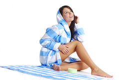 Woman after shower applying cream Royalty Free Stock Images