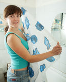 Woman with shower curtain Royalty Free Stock Images