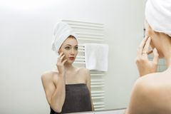 Woman From Shower Looking her Face at the Mirror Royalty Free Stock Photos