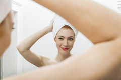 Woman From Shower Looking her Face at the Mirror Royalty Free Stock Photography