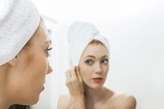 Woman From Shower Looking her Face at the Mirror Stock Images