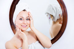 Woman after a shower near mirror Stock Images