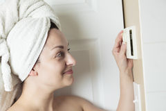Woman shower thermostat. A woman in shower rise up thermostat Stock Image