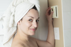 Woman shower thermostat. A woman in shower rise up thermostat Royalty Free Stock Image