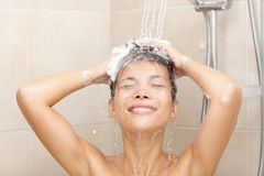 Woman in shower washing hair Stock Photography