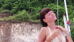 Woman showering at the beach of tropical island Bali, Indonesia. stock video footage