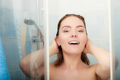 Woman showering in shower cabin cubicle. Girl showering in shower cabin cubicle enclosure. Young woman taking care of hygiene in bathroom stock images