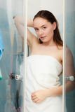 Woman showering in shower cabin cubicle. Royalty Free Stock Photo