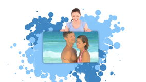 Woman Showing A Couple Embracing On The Beach Stock Photo