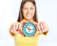 Woman showing alarm clock Royalty Free Stock Image