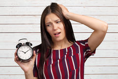 Woman showing alarm clock Royalty Free Stock Photography